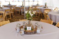 A wood slab centerpiece definitely adds rustic charm to any reception table. - #CowgirlWedding #CountryWedding