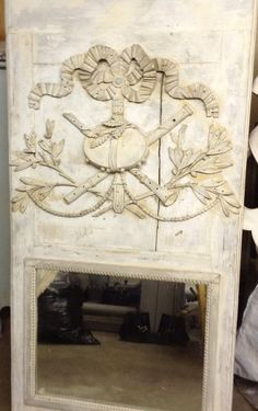 18th century French trumeau large mirror, carved musical/floral motif with bow garland and leaves, sublime colors, off white, pale gray.