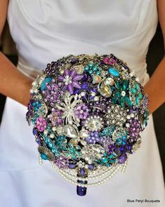Brooch bouquet -ahhhhh, I'm in LOVE. You can't toss it though.. You might kill someone.