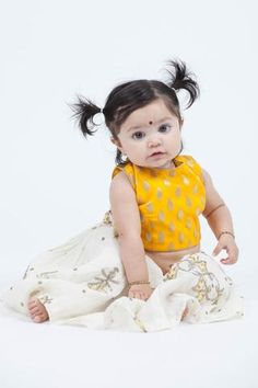 Mal cotton lengha with ethnic embroidery pairs with a yellow brocade blouse. Open back blouse design with hook closure. Kids Dress Wear, Kids Gown, Dresses Kids Girl, Little Girl Outfits, Kids Outfits, Baby Dresses, Designer Kids Wear, Designer Kids Clothes, Designer Dresses