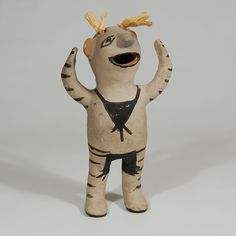 "#adobegallery - Cochiti Pueblo Standing Clown Pottery Figurine. Unidentified Artist      Category: Figurines     Origin: Cochiti Pueblo     Medium: clay, pigment, corn husk     Size: 9-3/8"" height x 5-1/4"" width     Item # 25823"