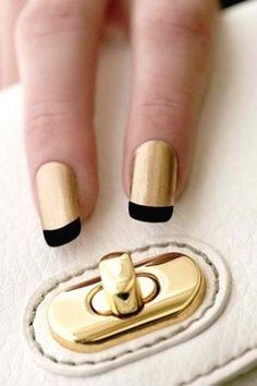Gold nail. Black French tip