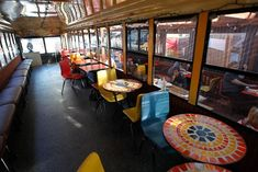 SoMa StrEat Food Park in S.F. offers indoor tables, inside a converted school bus, as well as outside along with food trucks. Photo: Mathew ...