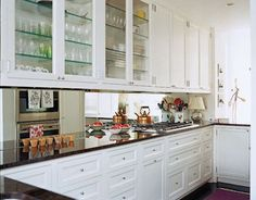 "Mirrors Work Magic  A mirrored backsplash in this shabby-chic Manhattan apartment gives the illusion of more space. ""The kitchen opens up to the living room on one side and the family room, where we eat and watch TV, on the other,"" says designer Faye Cone. ""The idea was that it should be an extension of both these spaces."""