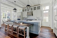 Farmhouse kitchen with reclaimed wood floors. Farmhouse kitchen with reclaimed…