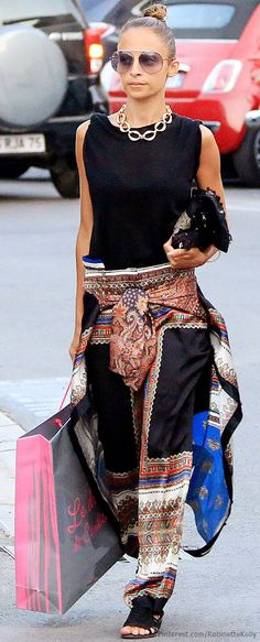 Street Style | Love the skirt look in back (it's actually the matching shirt just tied around her waist)