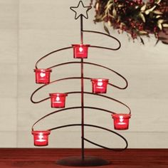 "Tremont Treescape Candleglow Makes for a fantastic, modern-day holiday candelabra for your dining table or buffet! New lower price! Includes red glass votive cups. 12-1/2""L X 7""W X 20-1/2""H - See more at: http://dollinewillis.athome.com/12108734-tremont-treescape-candleglow.html#sthash.xSocK11L.dpuf"