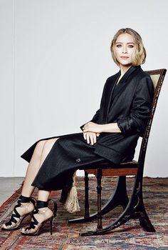 Mary-Kate Olsen // long pinstripe coat & lace up heels #style #fashion #beauty #mka