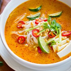 Vegetarian version of a flavorful Malaysian red-curry soup loaded with veggies, coconut-curry broth, and rice noodles. Gluten free.