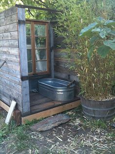 Outdoor bathhouse and greywater system.