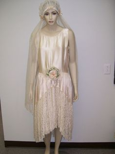 1920's Flapper Wedding Dress, champagne silk charmeuse and lace, sleeveless, short and a bit scandalous for the times, fitted waist with velvet and fabric flowers, full lace veil with satin flowers, snaps on left side, no labels. Front