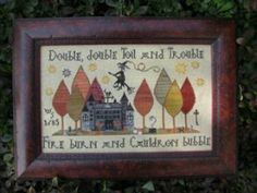 Toil and Trouble is the title of this cross stitch pattern from Plum Street Samplers. The cross stitch pattern is stitched with Gentle Arts Sampler Threads (Blueberry, Barn Grey, Mulberry, Raven, Soot, Sarsaparilla, Nutmeg, Summer Meadow, Gold Leaf, Apple Cider, Mustard Seed, Weathered Barn, Gingersnap, Cinnamon, Burnt Orange, Dried Thyme, Tarnished Gold, Oatmeal).