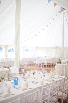 Yes bunting, yes shabby chic... very prettily done here, with beach huts as a special feature. The venue - Duncton Mill - has a very pretty lake if anyone is looking for a marquee venue in West Sussex, UK