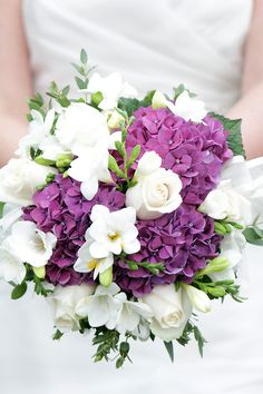 A beautiful bridal bouquet of freesias, roses and hydrangea. --like freesias and hydrangea but not roses