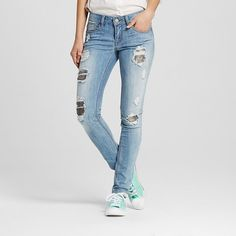 Play it cool in the Women's Destructed Sequin Skinny Jeans by Dollhouse (Juniors'). These heavily destructed jeans then pop with sizzle and sparkle, making them the rock star of your wardrobe.