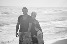 This is my family..  This picture is priceless to me...  I like different and the all white photos on the beach have been repeated so many times...  I wanted different..