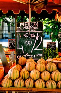 A market, Provence, France ~ These are the best melons in the world!