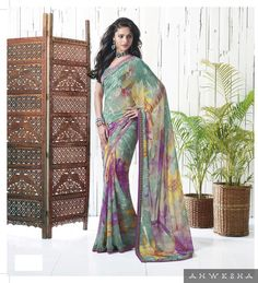 """We are offering a multi color designer printed georgette saare with dark cyan color. We have given a lace strip border to the saree so that it can add a value to your beauty. We are offering this saree with an exclusive unstitched blouse.   """