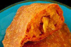 Guam's empanada is filled with a rice-annatto-chicken filling...the crust is annatto-masa harina. Annatto on Guam is called achote.
