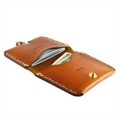 PRODUCT FEATURES: • Two compartments • Smooth and slim profile • Comfortable fit for hand and pocket • All stress points riveted • Hand sewn with waxed thread   OTHER COLORS AVAILABLE : Tan
