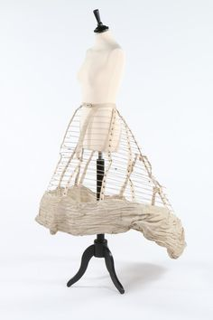 1860s Thompson cage crinoline (in a very crumpled condition!). With a bag bottom reinforced by laced grommets. Kerry Taylor Auctions. [jrb]