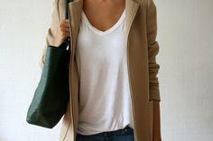 camel coat and drapey white tee