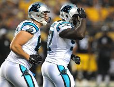 Carolina Panthers defensive end Mario Addison, right, salutes the bench after making a stop during first quarter action vs the Pittsburgh Steelers on Thursday, September 3, 2015 at Heinz Field in Pittsburgh, PA.
