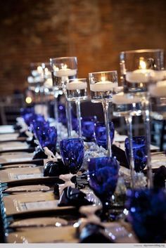 Making a visual statement with a pop a color (blue is my fave) enhanced by varying height candles is a fashion forward must-do!