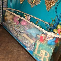 Room 6b The Monster High Living Room doubles as a bedroom for Lagoona Blue in her aquarium bed styled in an oblong flower vase. http://www.superbuddiesforever.com/ #monsterhighdollhouse #dollbed