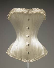 Ivory silk satin corset, masses of boning, classic shape. One of my favourite antique corset images ever. Satin fully-boned corsetry can be the perfect foundation for full bridal ensembles.