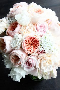 Bridal bouquet of juliet garden roses, allium, lizzy carnations, sweet avalanche roses, fringed white tulips and libretto parrot tulips by Floret Cadet - www.floretcadet.com