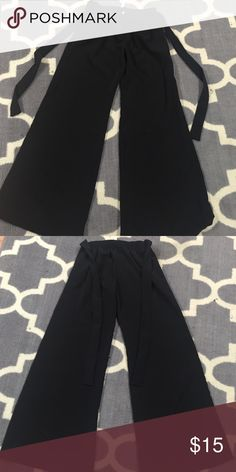 Black Pants Black dress pants with bow tie. They have an elastic band in the back. 100% Polyester. True to size. New with tags. My Beloved Pants Trousers