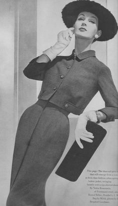 Dovima in charcoal gray wool cap-sleeved sheath worn under a short bolero by Nettie Rosenstein, clutch by Milch, hat by Lilly Daché - Photo by Horst, Vogue, December 1955 Fashion Mark, 50 Fashion, Fashion Dolls, Fashion Design, Fashion Women, Fifties Fashion, Retro Fashion, Vintage Fashion, Vintage Couture