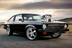 Shannon Longhurst's tough black-on-black Torana LX hatch looks so slick even master painter Charley Hutton was impressed Australian Muscle Cars, Aussie Muscle Cars, Big Girl Toys, Girls Toys, Holden Wagon, Holden Muscle Cars, Holley Efi, Holden Torana, Holden Commodore