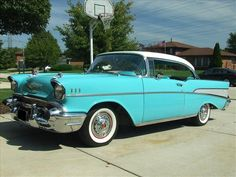'57 Chevy in teal... a true classic. My dad had one and I believe it was his favorite car ever.