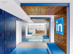 Connections Are Multiplying: Toronto LinkedIn Office | A birch pattern, digitally printed on vinyl wall covering, meets panels veneered in walnut in an elevator lobby.