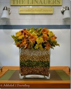 Love the peas and beans in this Thanksgiving arrangement!
