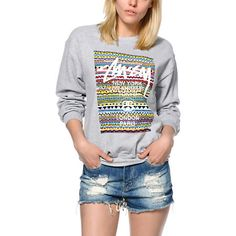 A colorful tribal print graphic with city names is printed on a boyfriend fit crew neck sweatshirt with a soft fleece lining for maximum comfort and style.