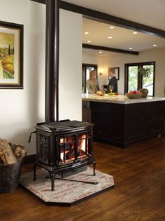 The Birchwood free-standing gas fireplace provides the detailing ...