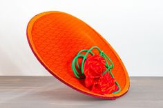 AUDREY BROWN | Wide-Brim Orange Hat Melbourne Cup | FORD MILLINERY    $720  Taking influence from Little Shop of Horrors and Peanut's Charlie Brown, Audrey Brown is one crazy little lady. Sophisticated, confident and deliciously bold, her rich colours (which have not been photoshopped!) are enough to make one salivate. A wide-brimmed hat with asymmetric upturned lip, the outer/top side is a tangerine orange with delicate darker fan print. A fan-inspired flower has been hand-crafted from… Fascinators, Headpieces, Spring Racing Carnival, Orange Hats, Little Shop Of Horrors, Wide Brimmed Hats, Melbourne Cup, Millinery Hats, Charlie Brown