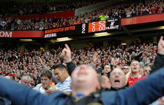 Fans go mental and celebrate one of United's most famous results after thrashing rivals Arsenal at Old Trafford in August 2011