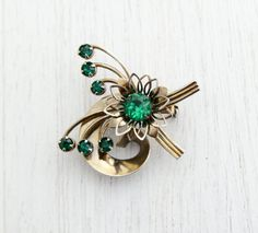 Vintage Green Rhinestone Brooch - 1960s Gold Tone Flower Spray Costume Jewelry Pin / Artistic Emerald Green by Maejean Vintage on Etsy, $12.00