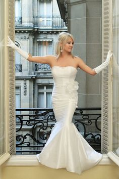 """""""What makes this unforgettable for me is it's a picture of my wife Lisa, taken on our wedding day at the Hotel de Crillon in Paris. We had returned from our ceremony at the Eiffel Tower, and were back in our room. Lisa stepped onto the windowsill. The framing, symmetry, elegance, and beauty just fit together perfectly..."""""""