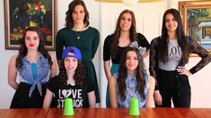Cups from Pitch Perfect by Anna Kendrick - Cover by Cimorelli. They do this VERY well. I have this song stuck in my head all the time. :]