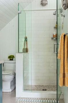 A subway-tiled shower enclosed with frameless glass makes for a functional and unfussy bath for teens.   Photo: Michael J. Lee   thisoldhouse.com