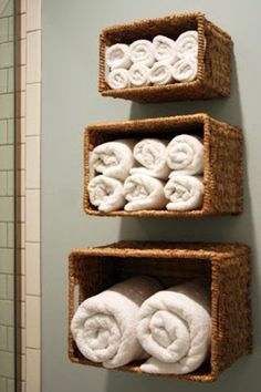 12 DIY Hacks To Create Your Dream Apartment buy a three set of baskets and hang on the bathroom wall as towel storage