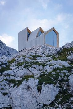 The internal shell is made from Larch timber panels and flown in  by helicopter in 3 units.  It is a remote alpine hiker's shelter for up to 8 people.