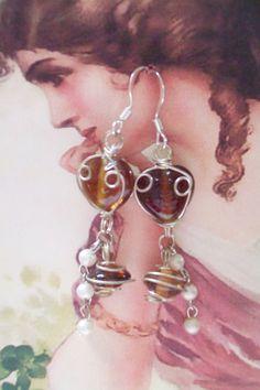 Southern OOAKS faerie inspired heart earrings. Sterling silver fish hook earrings.