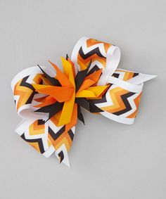 This festive fall clip takes colorful ribbon and turns it into an artistic delight. Built with an alligator clip in back, it slides into locks and doesn't fall off.4'' WPolyesterMade in the USA
