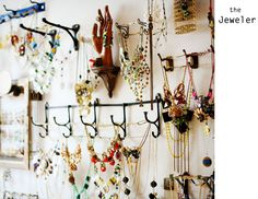 another jewelry wall.  never thought to use those hooks.  rather ingenius of someone.